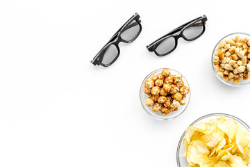 Fast food for watching film. Crisps, popcorn, rusks near glasses on white background top view copyspace