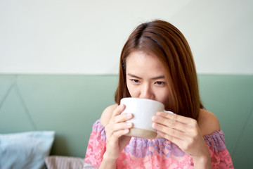 Portrait of a beautiful young asian woman drinking coffee at cafe