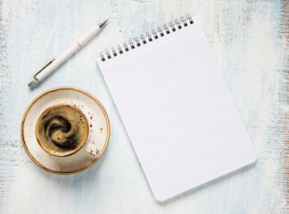 Morning coffee and notepad