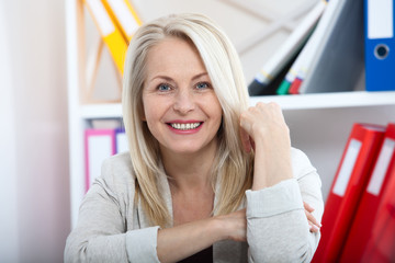 Modern businesswoman. Beautiful middle aged woman looking at camera