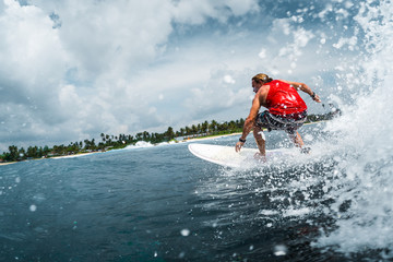 Surfer rides the ocean wave with lots of splashes