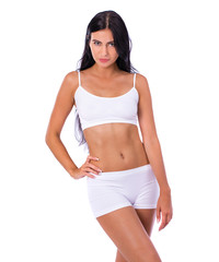 Sexy woman in white fitness clothing