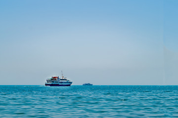 Pleasure boat and a yacht at sea on a sunny day