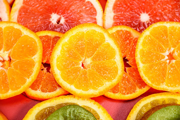 background of oranges of mandarins and grapefruits