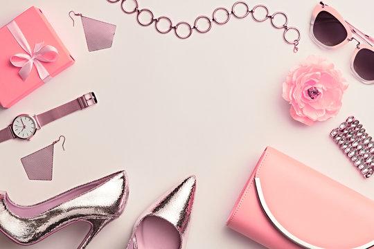 Fashion. Woman Accessories Set. Trendy Gold Heels, Watch, Summer Sunglasses, Glamour fashion Yellow Clutch. Flower. Flat lay. Luxury Stylish Spring lady