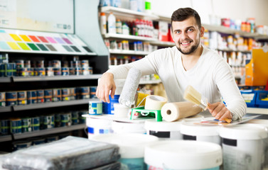 Male customer purchasing tools for house improvements