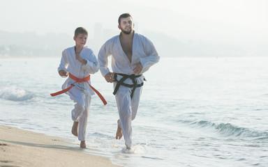 Foto op Aluminium Vechtsport Man and boy exercising karate