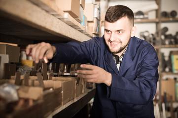 Attractive man worker sorting sanitary engineering details