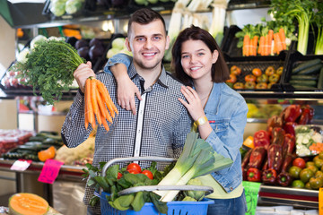 Couple choosing vegetables