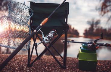 Fishing. Fishing equipment at the sunset. Sport, recreation concept