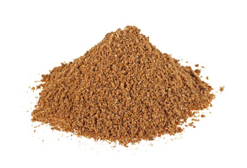 Heap of coriander powder on a white background