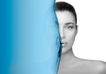 Greyscale beauty portrait of a gorgeous brunette. Moisturizing skin care concept