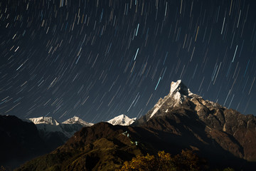Machapuchare (Fish Tail) mountain in the starry sky. Nepal, Himalayas