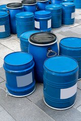 Blue barrels bottom up for tables and chairs.