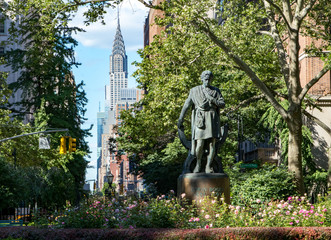 Fotobehang New York New York City cityscape scene in Gramercy Park with the Midtown Manhattan skyline skyscrapers in the background