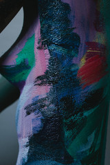 Closeup view of female ribs with bodyart