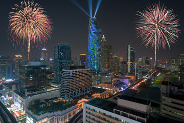 Night view 2018 new year celebration with skyscraper in business district in Bangkok Thailand. Light show at Magnolias Ratchaprasong in Bangkok, Thailand.