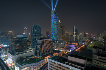 Night view with skyscraper in business district in Bangkok Thailand. Light show at Magnolias Ratchaprasong in Bangkok, Thailand.