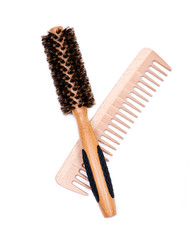 Round natural bamboo hairbrush with wild boar bristles and wooden comb isolated on white background