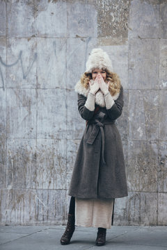 Beautiful woman wearing fur hat and scarf