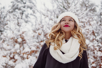 Beautiful portrait of a woman smiling in winter snow