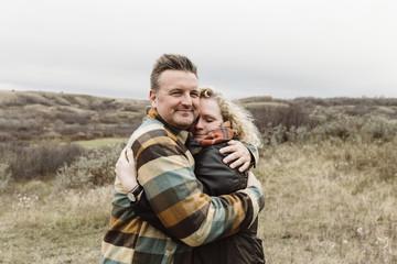 Outdoor portrait of attractive couple hugging