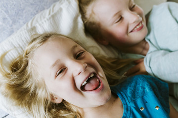 Young sisters laughing and playing together