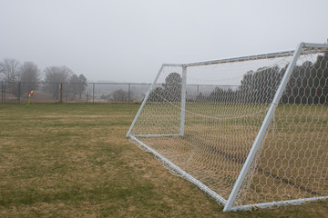 Empty soccer goal in winter