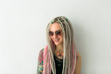 happy dreadlocked young woman