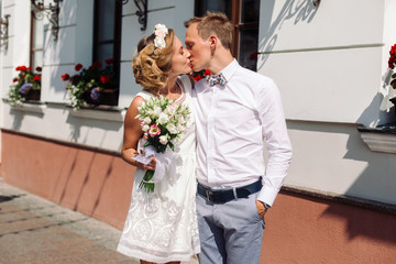 Young stylish couple in love posing on the street. Wedding  photo