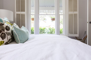 View of the garden from a luxury styled master bedroom