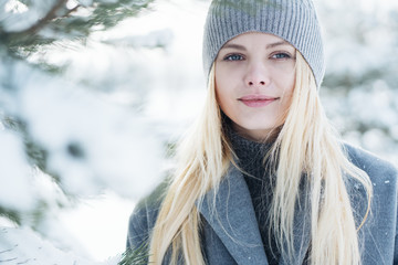 portrait of a beautiful young girl in winter