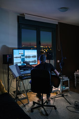 Young Man Recording Guitars at his Home Sound Studio