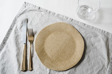 Neutral minimalist dinnerware plate styling on white table