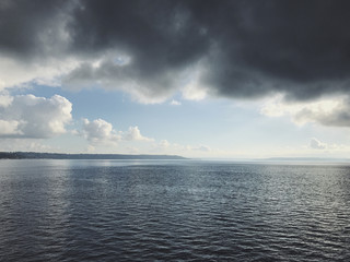 Overcast sky and calm waters of Puget Sound, Seattle, WA
