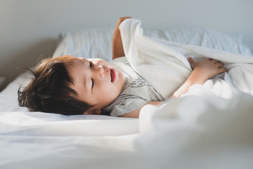 Toddler resting in bed
