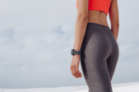 Closeup of fit woman wearing workout clothes