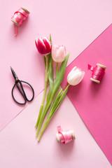 Preparing pink tulips bouquet