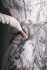 Beautiful alternative model in white artistic dress shot in studio