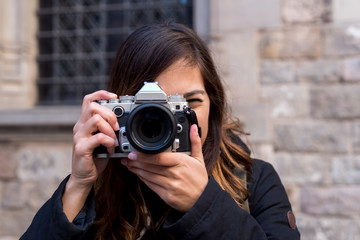 Young woman shooting on camera