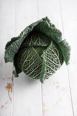 Savoy cabbage on white background.