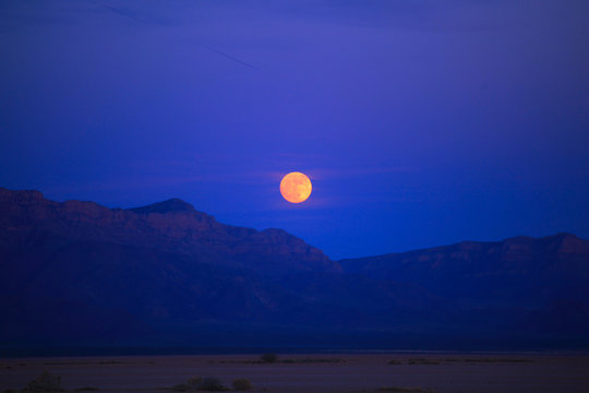 Super moon over red mountains
