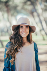 Portrait of smiling female in hat
