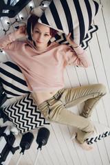 Beautiful redhead woman lie down on a floor