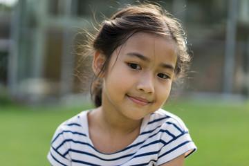 Asian cute little girl striped shirt dress