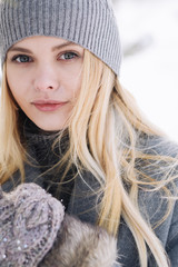 portrait of a beautiful girl in winter closeup