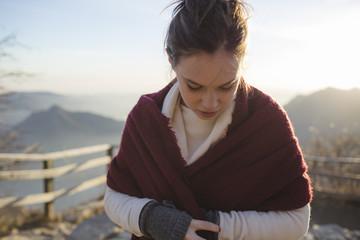 Beautiful girl wearing a scarf outdoors