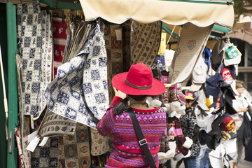 Travelers asian thai women selecting and shopping fabric and crafts product at handmade street market, Italy
