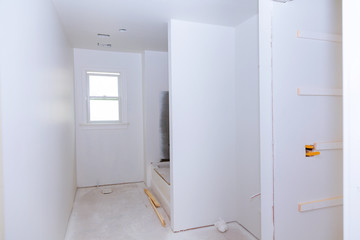 New under construction bathroom interior with drywall and patching