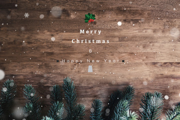 Merry Christmas and Happy New Year text on wood table